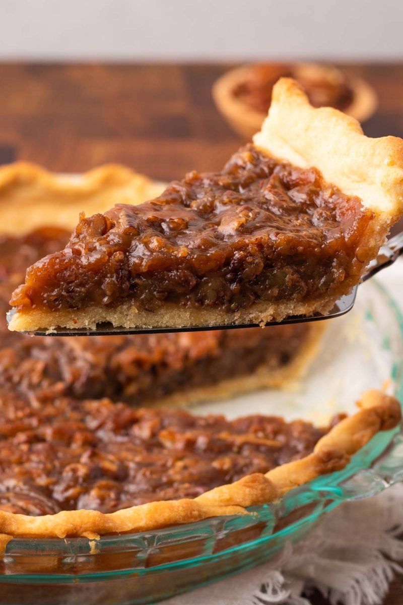 slice of plant based pecan pie removed from the whole