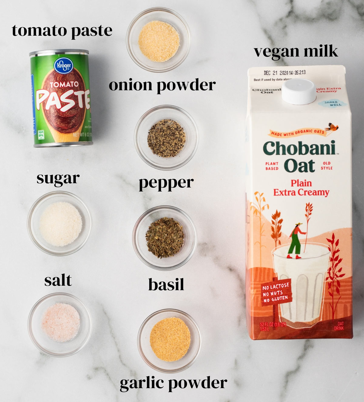Ingredients for vegan tomato soup: Tomato paste, oat milk, and seasonings.