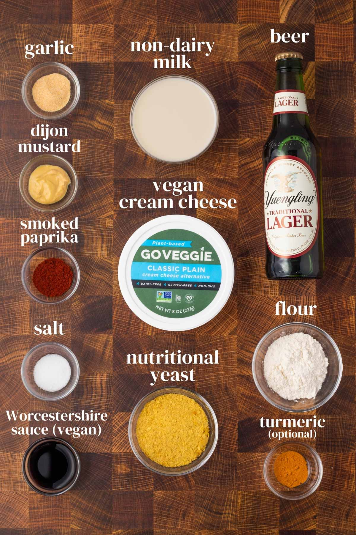 ingredients for homemade vegan cheese dip with cream cheese, nutritional yeast, paprika and beer
