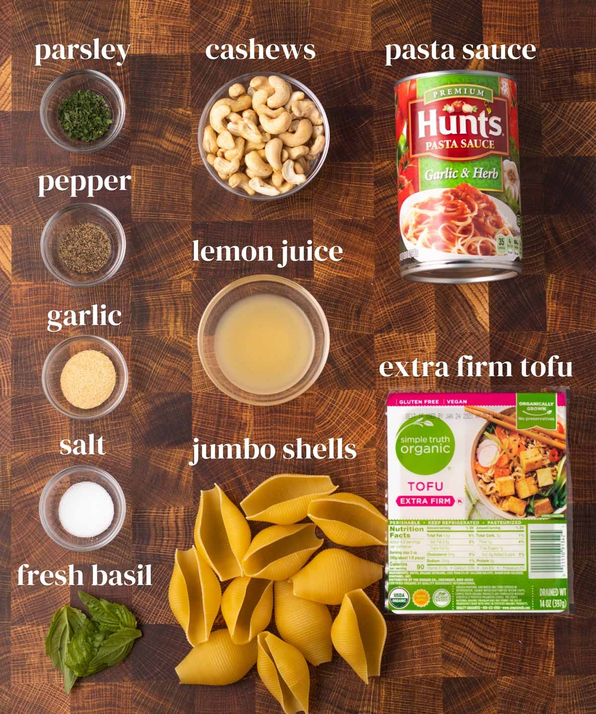 ingredients for vegan stuffed shells into tomato sauce with plant-based tofu ricotta