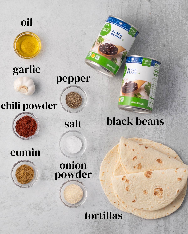 ingredients for tacos: chili powder, cumin, onion powder, tortillas, black beans