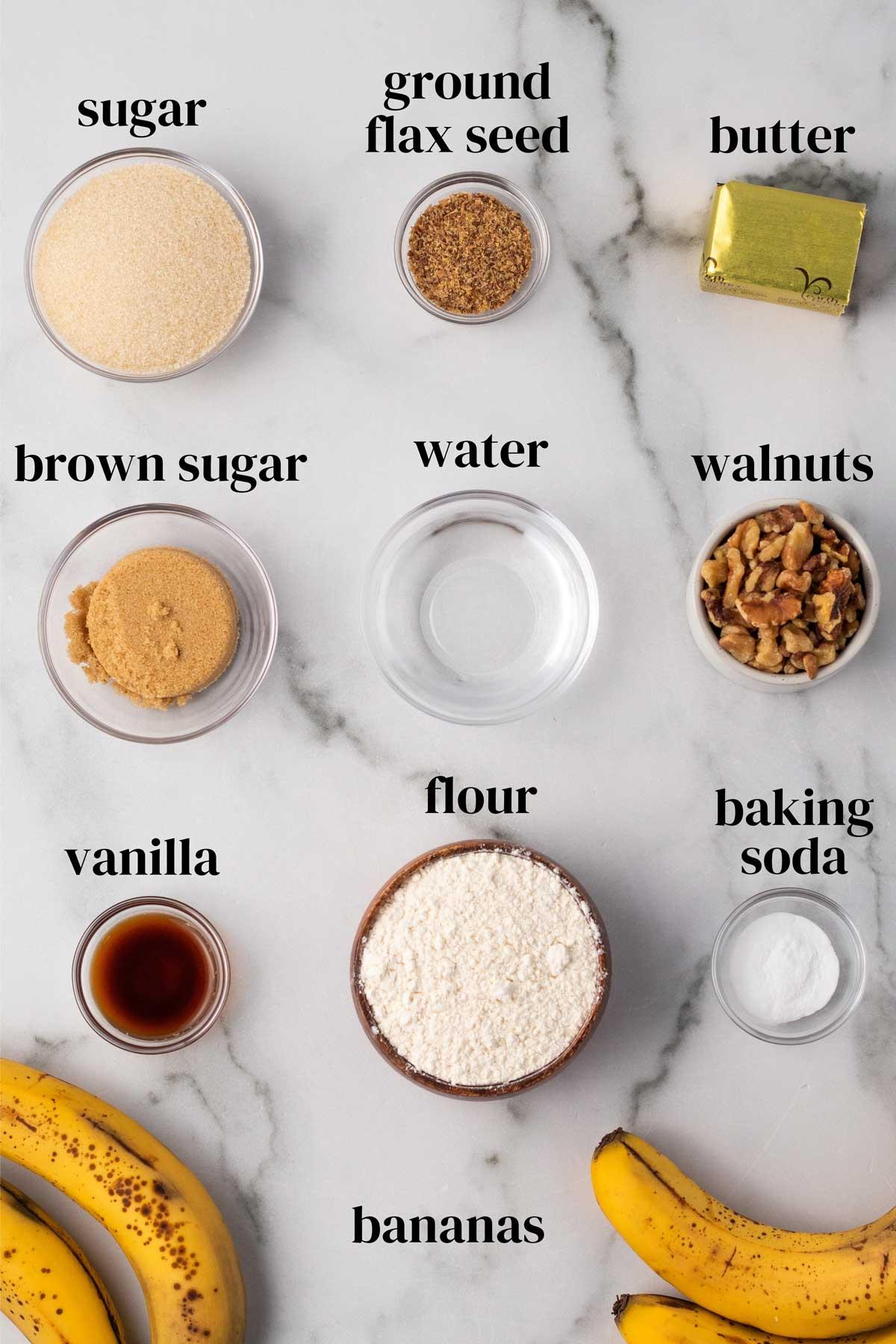 Ingredients to bake vegan banana walnut muffins with flour, sugar, baking soda, vanilla and bananas