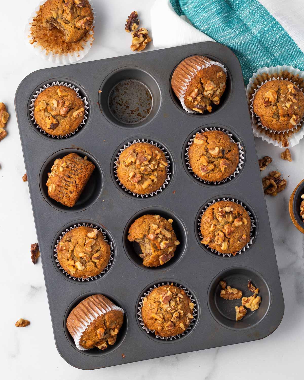muffin tin filled with vegan banana walnut muffins