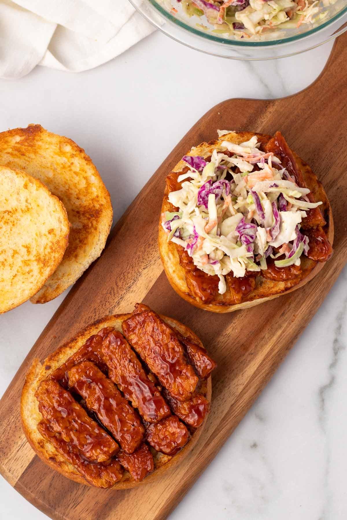overhead of vegan bbq tempeh sandwich with coleslaw
