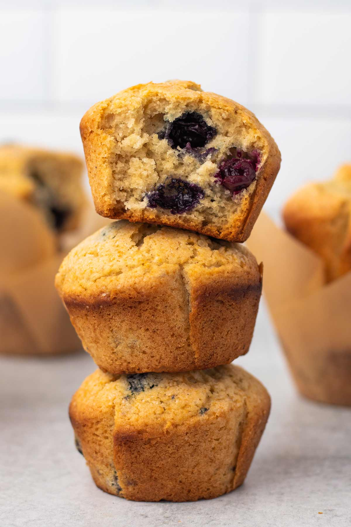 close up on a stack of three vegan blueberry muffins