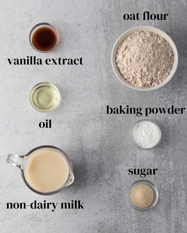 ingredients to make gluten-free vegan pancakes with oat flour and non-dairy milk.