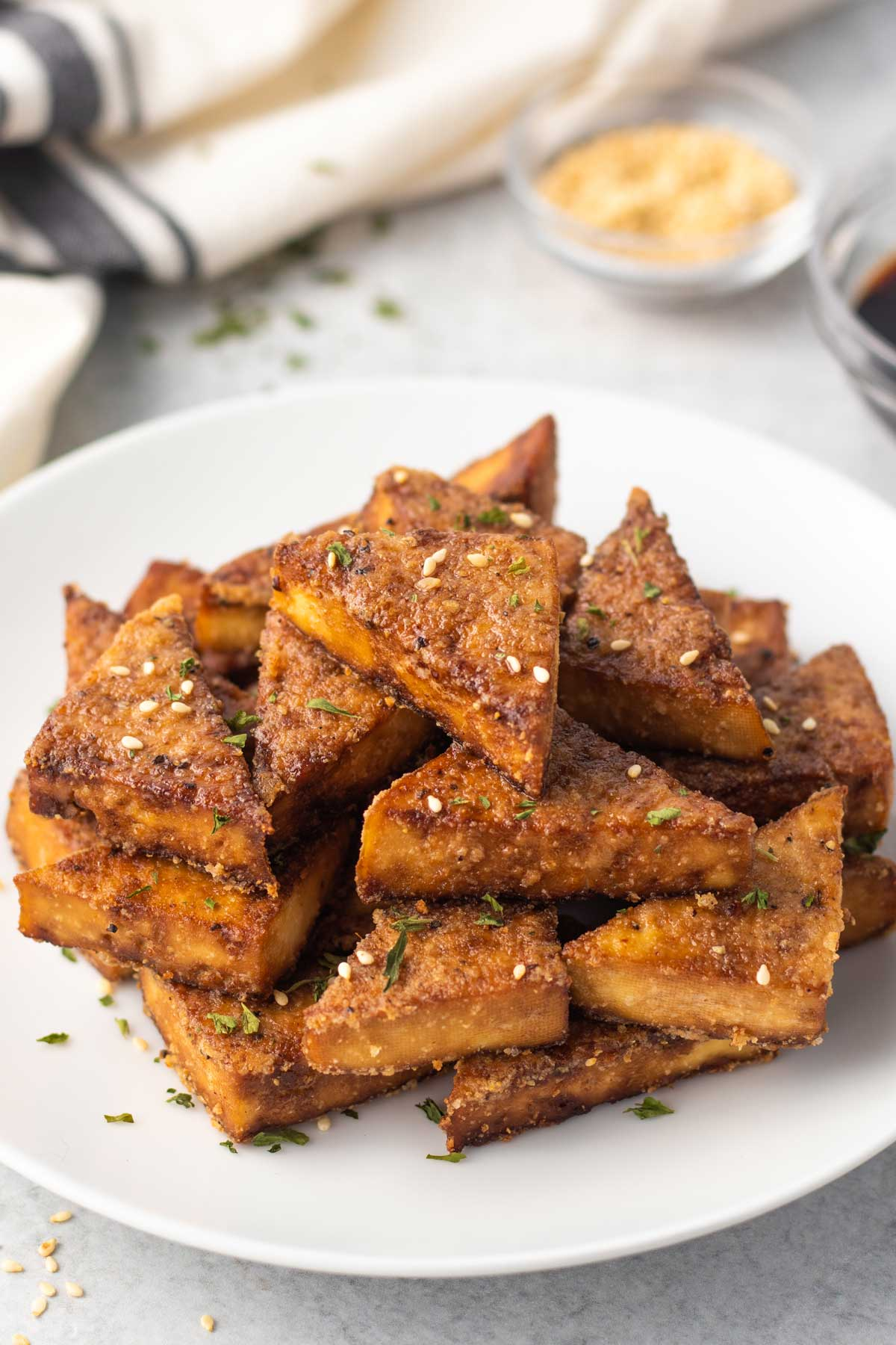 plate with triangles of crispy baked tofu with sesame seeds