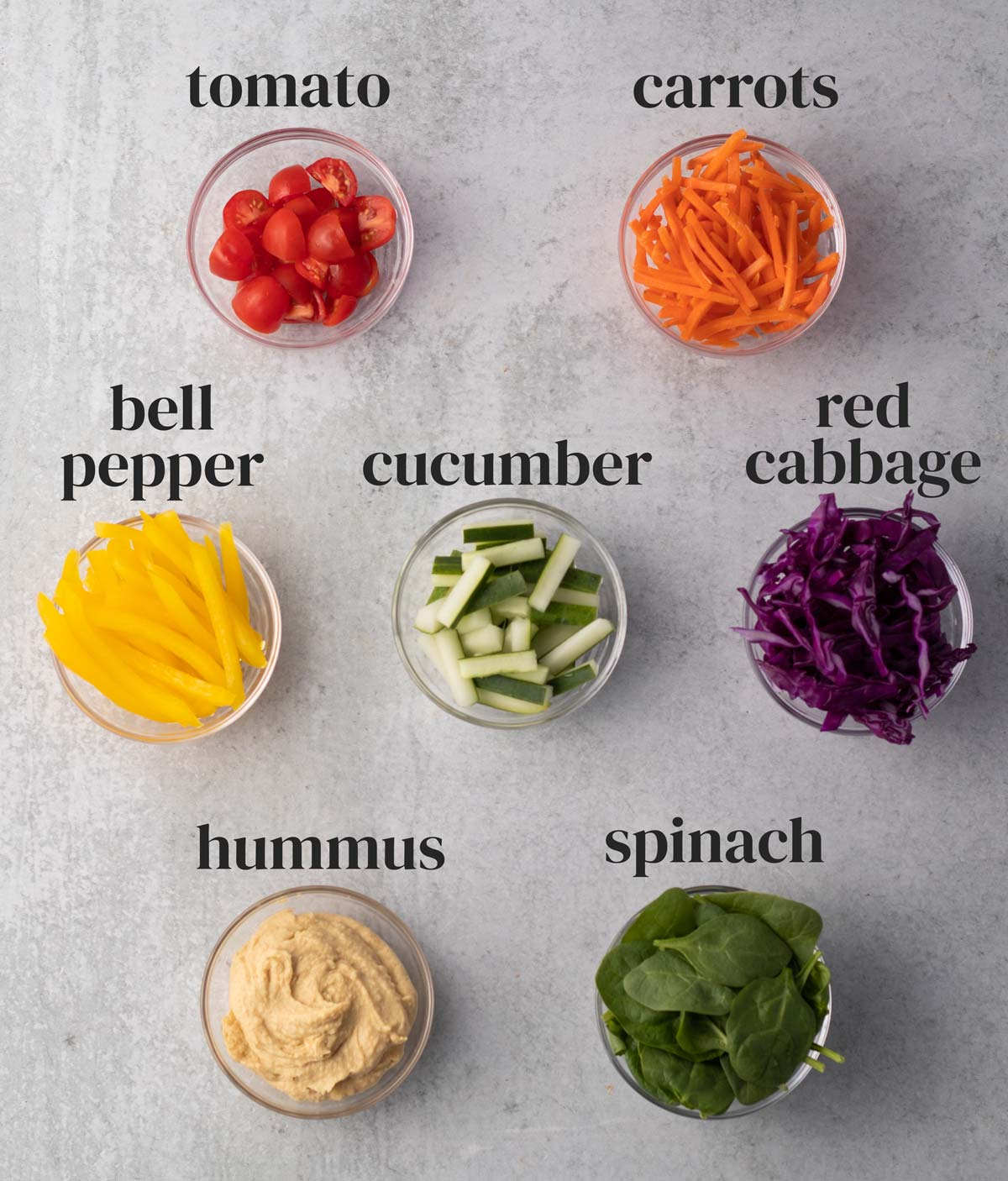 ingredients for vegetable wraps in small bowls