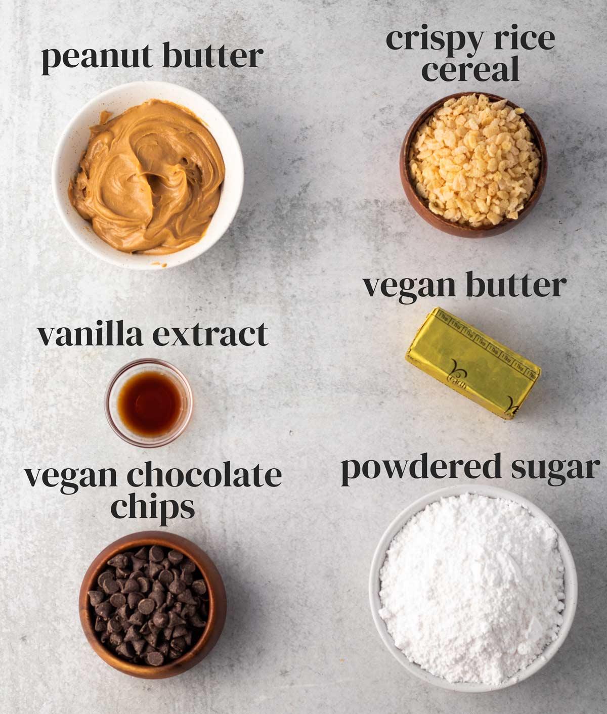 ingredients for vegan buckeyes in bowls on a countertop