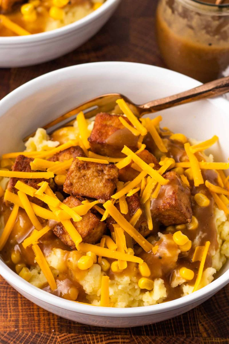 vegan KFC famous bowl with dairy-free cheese, corn and dairy