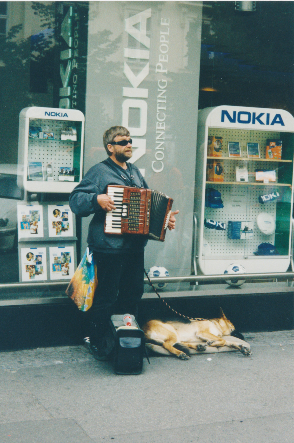 """I love this blind guy and always give him a lot of money. (Edit 2014: He's still there and I still do!) He always replies """"děkujeme"""", """"we thank you"""", referring to him and his dog."""