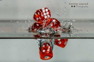 Red Dice falling into water inverted 1