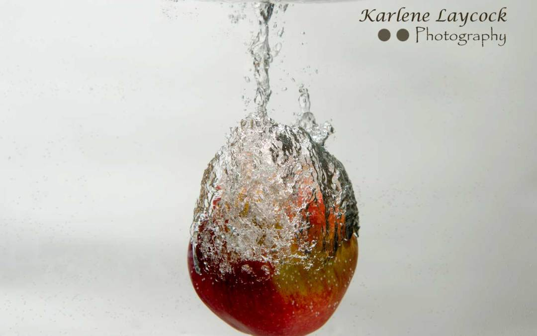 Red Apple encased in water bubble on grey series 3