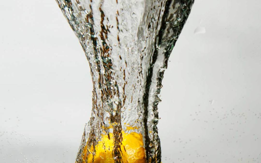 Lemon falling into water on grey series 2