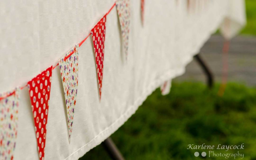 Red & Multicoloured Bake Off Bunting on a White Table Cloth