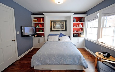 A flat screen TV is on an articulating mount. A standard queen sized bed can be folded down when guests are in town.