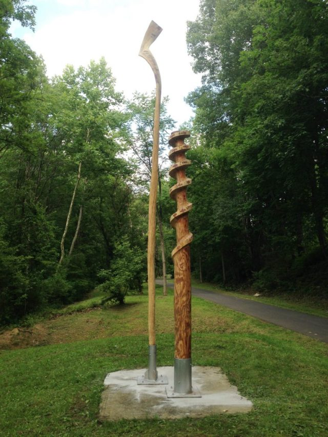 Loren Madsen's Nobori sculpture: two tall carved (accentuated) trees