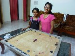 Back at the homestay, Suhan and Sumana (daughters of the owners) showed me how to play carom. They schooled me of course but it was fun.