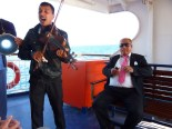 "On the ferry to Bozcaada island (pronounced ""bo-JAH-da"")... I couldn't believe that this dude in the pink tie AND the traveling musician came together in the same ridiculous photo for me. Thanks, guys."