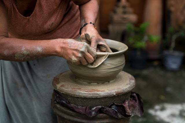https://www.pexels.com/photo/woman-making-clay-pot-2166456/