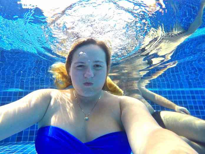 Relaxing in the swimming pool