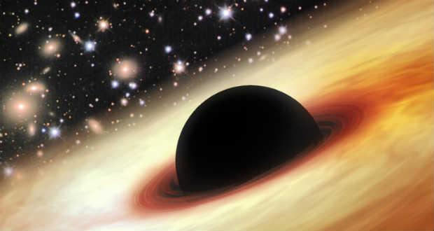 Túlméretezett fekete lyuk uralja egy ősöreg galaxis centrumát