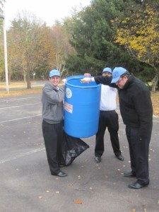 Volunteers hold garbage can