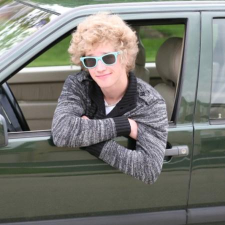 Cool teen hangs out car window