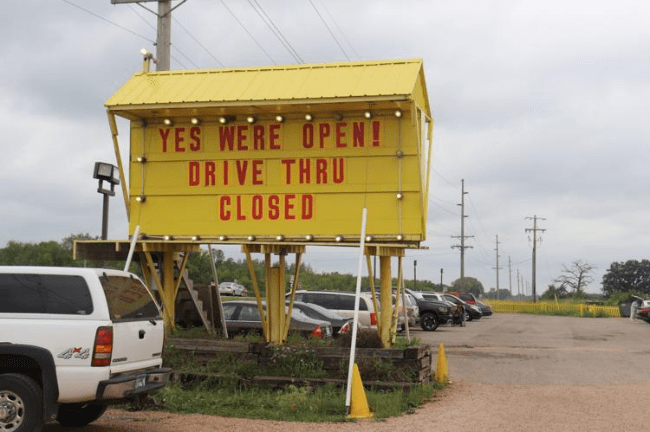 Post-crash sign on marquee leading to candy store. (screenshot)