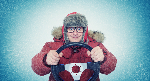 defensive driver wears snowsuit in blizzard while at the wheel