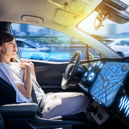 hands free woman rider in autonomous car
