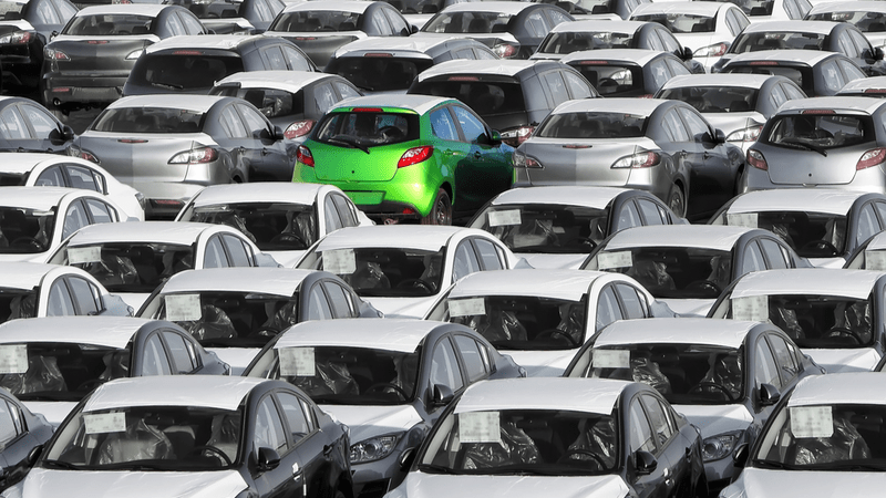 Green car stands out in a crowd