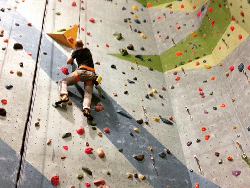 Photo of indoor wall climbing.