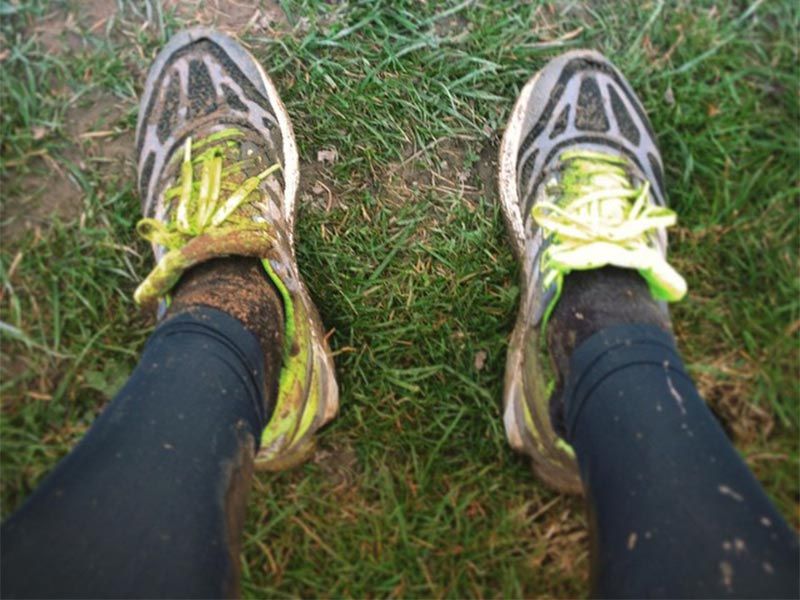 Photo of muddy running kit.