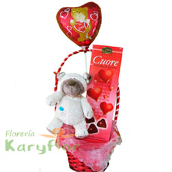 Canasta decoradas con peluche, globo Nº 9 y chocolate. Inlcuye tarjeta dedicatoria.
