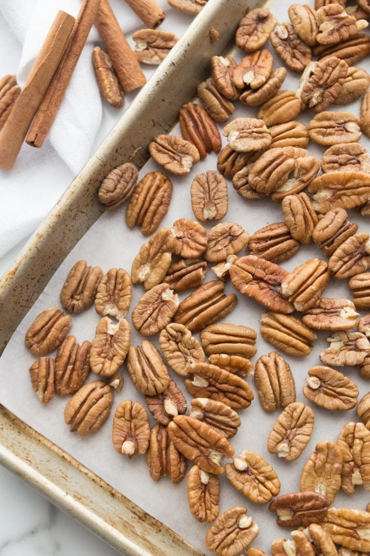 raw pecans on a baking sheet to roast