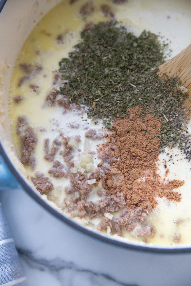 adding spices to the keto cheeseburger soup