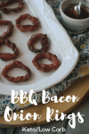 Keto Bacon wrapped Onion Rings on a white dish