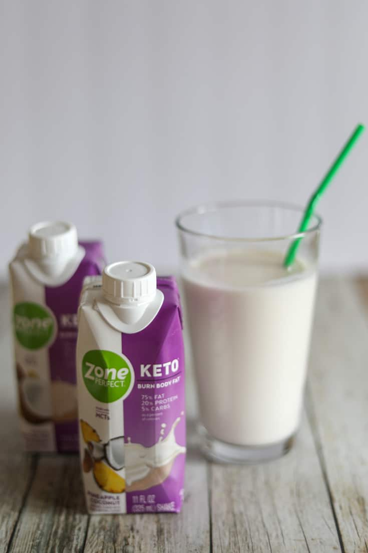 ZonePerfect Keto Shakes poured in a glass with a straw