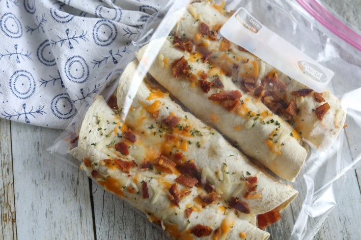 Four cheese, bacon and egg stuffed healthy low carb burritos in a clear freezer bag.