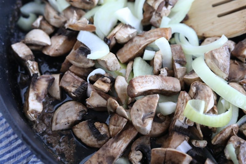 mushrooms and onions in a skillet