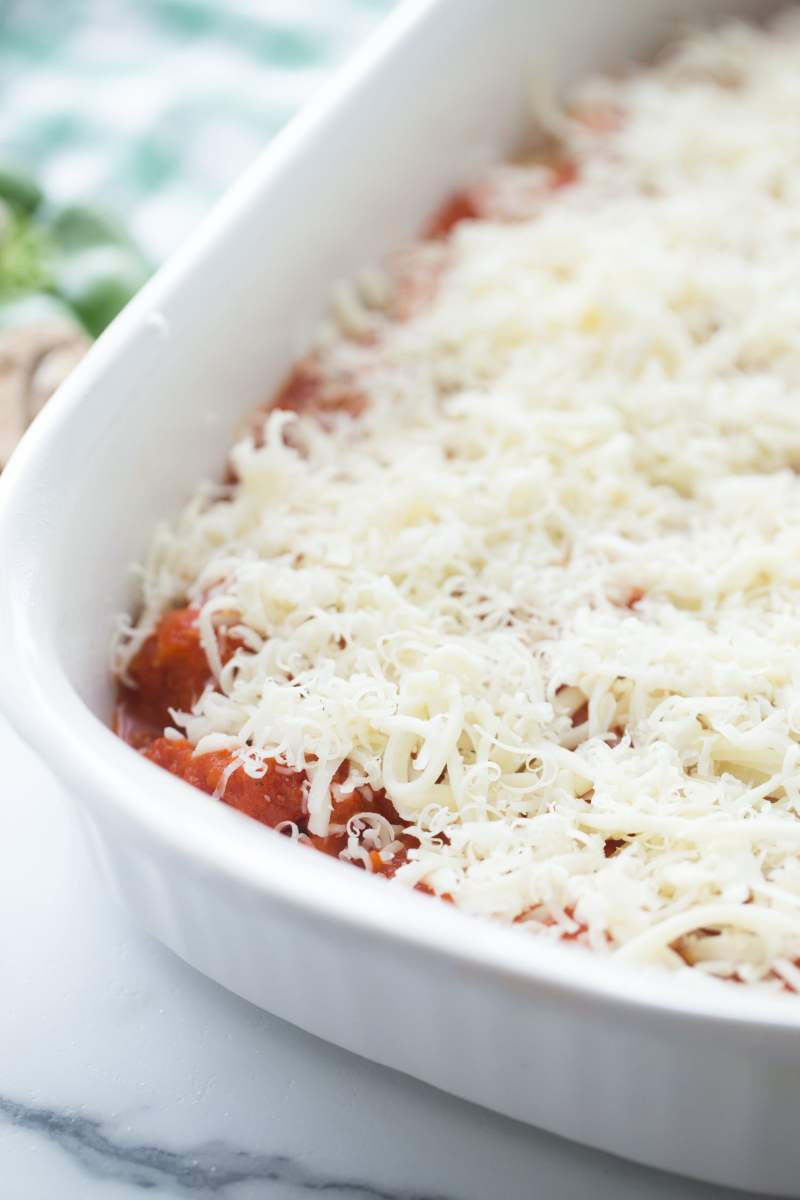 chicken tomato sauce and cheese layered in a casserole dish