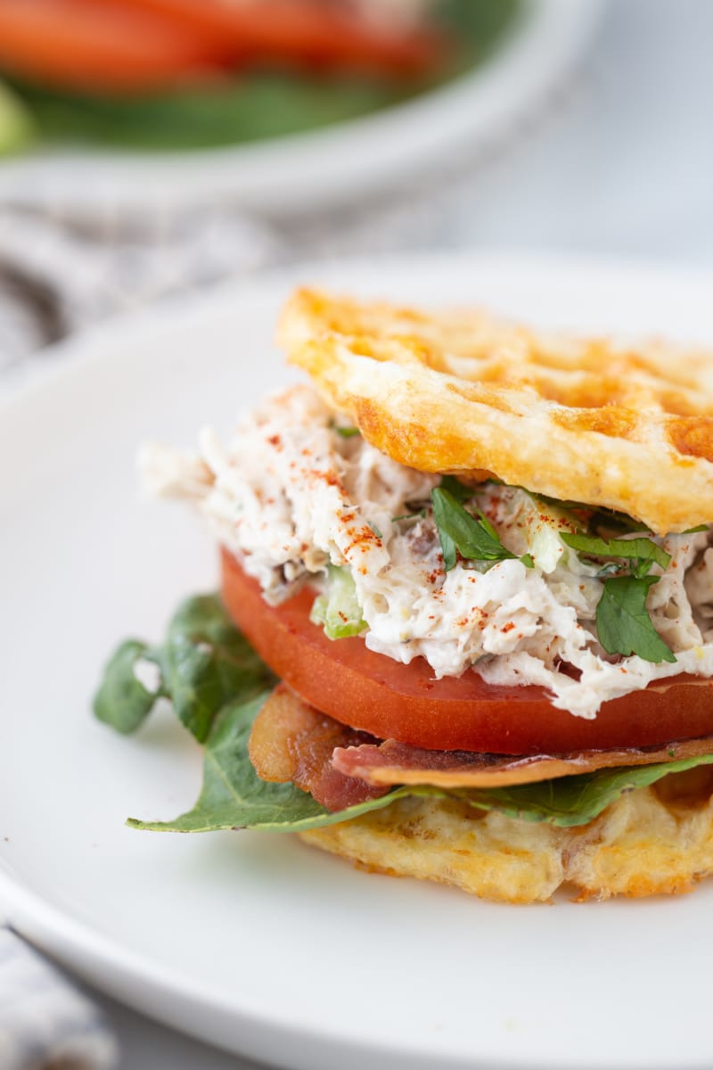 keto chicken salad chaffle sandwich with tomato