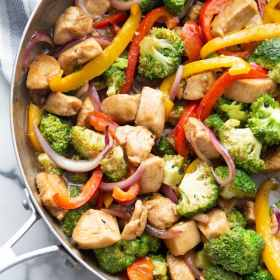 chicken stir fry with vegetables in a skillet