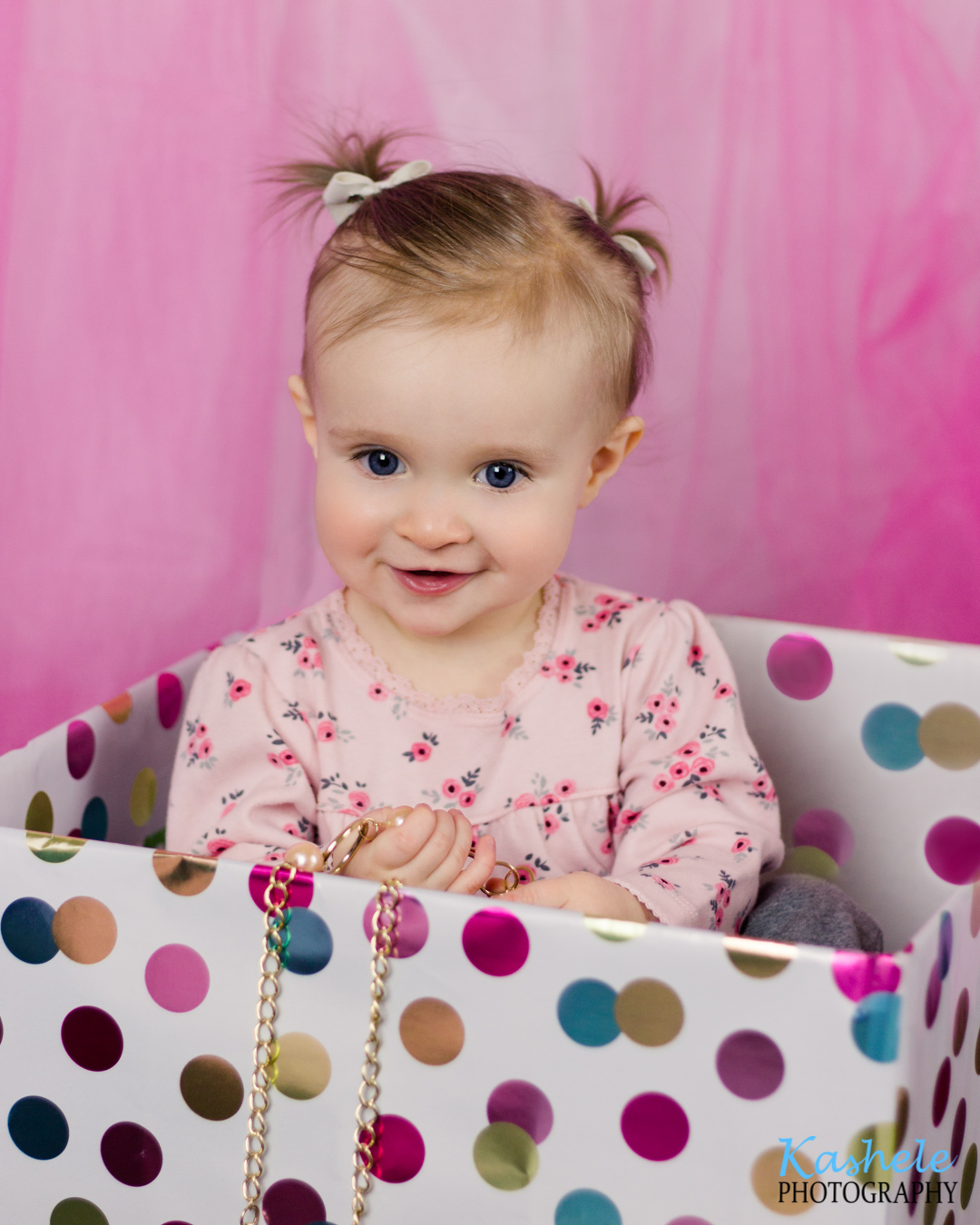 Image of baby girl in a birthday box from Miss Hardy's First Birthday Session