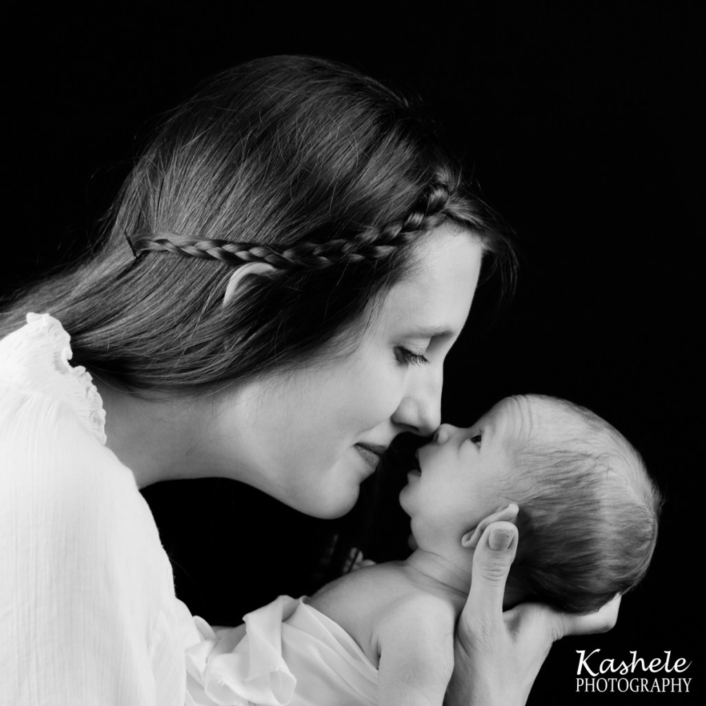 Utah County Newborn Photographer Mom and baby brother touching noses