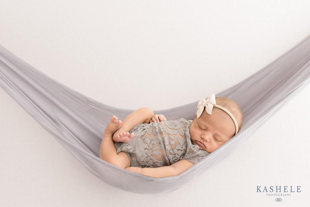 Newborn baby girl in a hammock