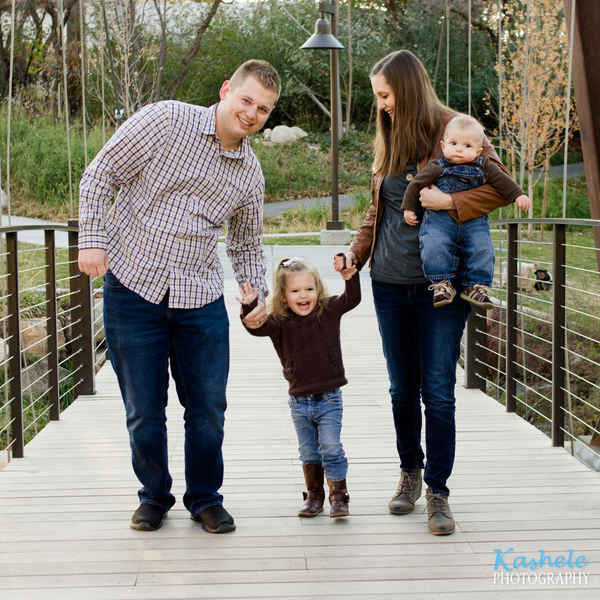 2019 Fall Family Session Thomas family of 4 playing on the bridge