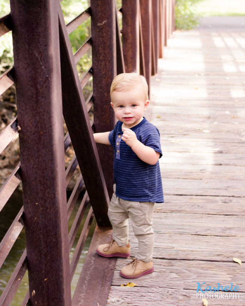 Image of little man smith throwing sticks from the bridge