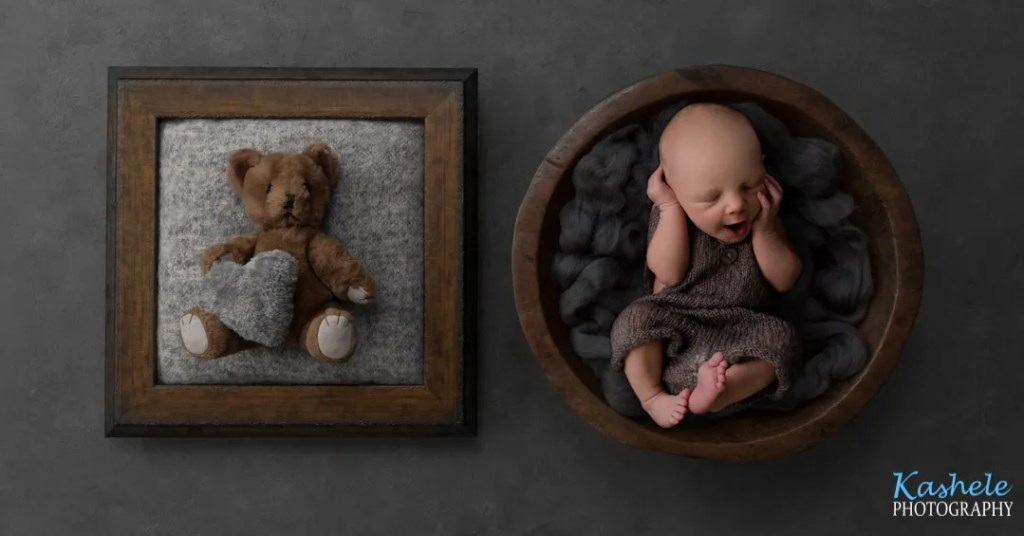 Image of baby in a bowl next to a framed bear for Alexis' Rainbow Baby